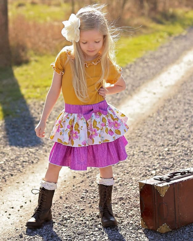 Phoebe's Drop Waist Dress | The Simple Life Pattern Company PDF sewing pattern girls tween knit woven combo dress ruffle neck ruffle sleeves bow belt sash single double tier skirt back to school dress fall winter spring summer sewing dress pattern downloadable shirt dress