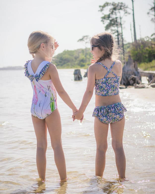 Simple Life Pattern Company | Harbor's Flutter Back Swimsuit Downloadable PDF Sewing Pattern for Girl's and Toddler Sizes 2t-12 Simple Life Pattern Company | Harbor's Flutter Back Swimsuit Downloadable PDF Sewing Pattern for Girl's and Toddler Sizes 2t-12 Get ready for summer with Harbor's Flutter Back Swimsuit! The Harbor swimsuit has so many features.  This swimsuit features an elegant and unique back flutter strap with an optional center bow.  Adorable leg flutters make this suit perfect for your stylish little lady.  It also make the cutest leotard for dance and gymnastics. This swimsuit provides the perfect coverage while playing all day in the sun!! Marian's Criss-Cross Tankini & One-Piece Downloadable PDF Sewing Pattern for Girl's and Toddler Sizes 2T-12 Marina features the on-trend criss-cross strap in the back.  It can be sewn as a one piece or a tankini.  Both versions can feature the optional top ruffle or it can be made as a simple swimsuit without the ruffle.  The tankini also has an optional skirt ruffle for the ultimate girly swimsuit.  A shorten/lengthen line is included for the perfect fit and coverage you may want.