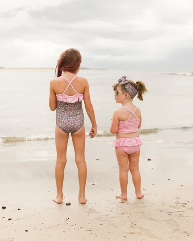 Simple Life Pattern Company | Marian's Criss-Cross Tankini & One-Piece Downloadable PDF Sewing Pattern for Girl's and Toddler Sizes 2T-12 Marina features the on-trend criss-cross strap in the back. It can be sewn as a one piece or a tankini. Both versions can feature the optional top ruffle or it can be made as a simple swimsuit without the ruffle. The tankini also has an optional skirt ruffle for the ultimate girly swimsuit. A shorten/lengthen line is included for the perfect fit and coverage you may want.