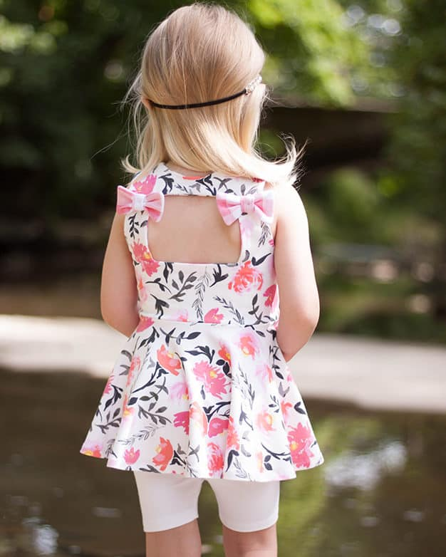 Simple Life Pattern Company | Skyler's Square Back Top & Dress Downloadable PDF Sewing pattern for toddler and girl sizes 2t-12 Skyler's Square Back Top & dress is loaded with is many options.   Skyler features three different back options, making this pattern the perfect staple for every season.  Open square back with side bows or a large center bow, square cutout back with side bows or a simple square back.  A modest line is available for those that love the look of the back but need a little more coverage.  Choose from sleeve tabs, short sleeves, elbow sleeves, long sleeves or sleeveless.  The higher bodice is perfect for adding embellishments or monograms.  You have the choice between a circle skirt or gathered skirt.  Peplum, tunic or dress length.  The top length pairs beautifully with the Tammy Tulip shorts.