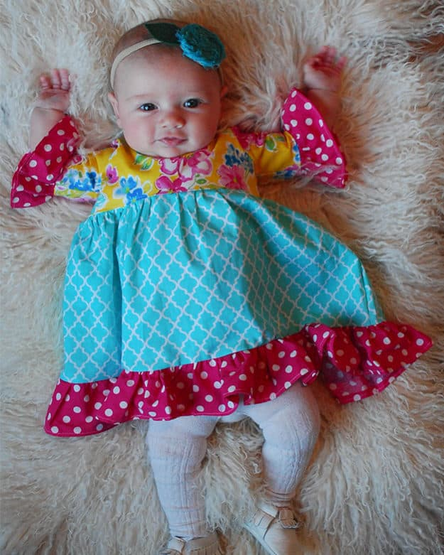 Baby Patricia's Boho High Low Top & Dress.. Downloadable PDF Sewing Pattern for Baby Sizes Newborn to 24 Months. Baby Patricia's is packed full of options. Starting with Top or dress length. It also has a sleeveless version, short sleeves, bell sleeves, and long sleeves. You can choose between the moderate high low hem or the dramatic high low hem. Baby Patricia can be made in knit or woven's and is very flattering in lightweight flowy types of fabrics such as voile or rayon. The back features a slight scoop back and has NO closures – just slides on over the child's head. Plenty of playing room without being boxy or too baggy. You will love how many looks you can achieve with just this pattern! And how quickly you can sew these up!