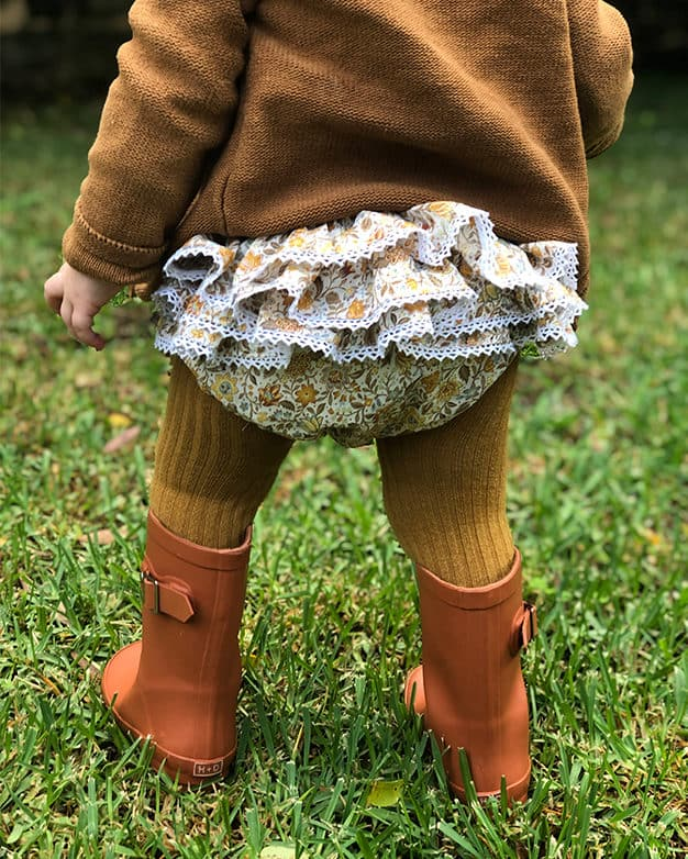 "Simple Life Pattern Company | Rosie's Ruffled Bum Bloomers. Downloadable PDF Sewing Pattern for Babies and Toddlers Size Newborn to 3T. Rosie's Ruffled Bum Bloomers are just the pattern you've been looking for. Featuring a ruffled bum and optional leg ruffles, you can create a variety of looks with this one pattern. Slim fit or bubble fit.  Uses 1/2"" elastic at the waist and 1/4"" elastic for the legs."