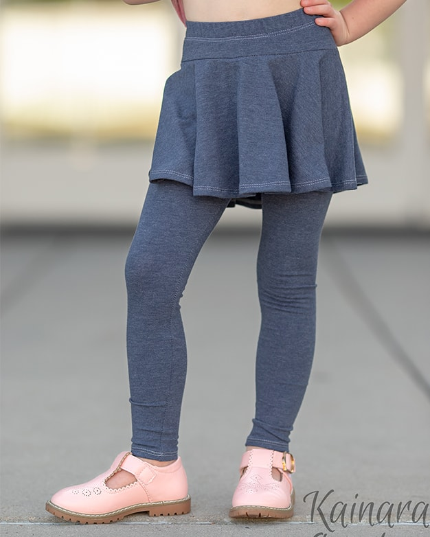 Simple Life Pattern Company | Roxie's Skirted Leggings. Downloadable PDF Sewing Pattern for Sizes Toddler and Girls sizes 2T-12. Roxie's Skirt Leggings are perfect for pairing with all our tops, especially the Lydia or Autumn. Roxie features 3 patterns in 1 pattern. Simple basic leggings, skirted leggings or a simple skirt.  There are three legging lengths- pants, capri or shorts.  Roxie features a waist yoke, elastic waistband and optional faux drawstring. This is sure to become a staple pattern for any season from back to school to hot summer days and everyday in between.
