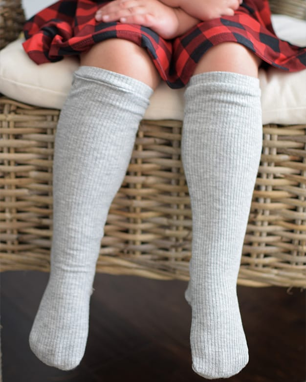 Simple Life Pattern Company | Sloane's Knee High Socks. Downloadable PDF Sewing Pattern for Toddler And Girl Sizes 2T-12. Sloane's Knee High Socks will keep your littles warm all winter long. Choose from ankle, crew or knew high length. Sloane is a fun way to use up all of those knit fabric scraps you have lying around. Perfect for the whole family.