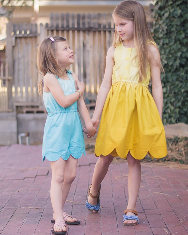 Simple Life Pattern Company| Tinsley's Scalloped Top, Romper & Dress. Downloadable PDF Sewing Pattern for Toddler and Girl Sizes 2T to 12. The perfect pattern for spring and summer sewing, Tinsley features super cute shoulder tie that lets just a little bit of the lining show through for the perfect contrast.  Choose from a swing top, dress or romper.  Choose scallop or simple hemline.  This pattern also features a front button placket and optional slash pockets.  Pair the swing top with Maggie's Suspender Shorts or Seaside Shorts for the perfect outfit.