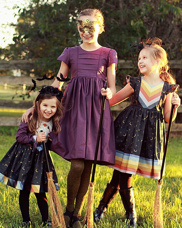 "Simple Life Pattern Company | Geneva's Vintage Bow Dress. Downloadable PDF Sewing Pattern for Toddler and Girl Sizes 2T-12. Designed for Woven Geneva's Vintage Bow Dress is a stylish dress with the most beautiful vintage feel.  Whether you are looking for an everyday dress or something more fancy for a special occasion this pattern will be a staple in your stash.  Featuring several stunning sleeve lengths: sleeveless, single flutter sleeves double flutter sleeves, an open short sleeve or long sleeve with ties...the styling options are endless! The bodice offers two gorgeous necklines, the traditional scoop neck or a more modern square neck.  You can choose a simple bodice, bodice with a simple center panel or bodice with a pin tuck center panel. Geneva includes several skirt options: a simple gathered vintage skirt, a gathered vintage skirt with center panel, a simple gathered dress skirt and a gathered dress skirt with center panel.  Vintage length is designed to fall 2"" above the knee while dress length will fall at the knee. The skirt is finished off with a classic deep 2"" hem, giving you the most stunning vintage look. The beautiful features don't stop there.  To finish off this stunning look you have the option to add to beautiful bows to the sides of the bodice."